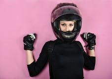 Girl in black with helmet Stock Photos