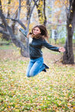 Girl in the black jacket jumps Stock Images