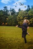 Girl in Black Jacket Standing on Green Grass during Daytime Stock Photography