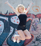 Girl in black jumping Stock Photography
