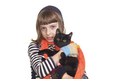 Girl with a black kitten Royalty Free Stock Photo