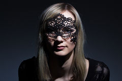 Girl in black lace mask Royalty Free Stock Image