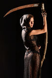 Girl in a black lace smock with scythe of death. Stock Photography
