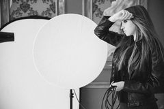 The girl in a black leather jacket a black-and-white photo Stock Image