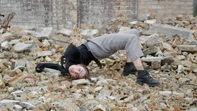 The girl lying scattered bricks stock footage