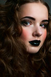 Girl with black lips and blush Stock Photos