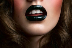 Girl with black lips and white teeth Stock Photography