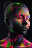 Girl with black make-up and colorful bodypainting Stock Photo