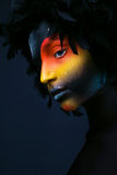 Girl with black make-up and colorful bodypainting Royalty Free Stock Photos