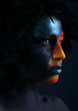 Girl with black make-up and colorful bodypainting Stock Photos
