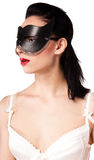 A girl in a black mask and corset Royalty Free Stock Photo
