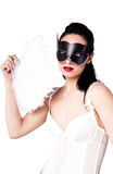 A girl in a black mask and a fan Royalty Free Stock Images