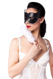A girl in a black mask and a fan Stock Image