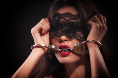 Girl in a black mask. And handcuffed Stock Photo