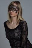 Girl in black mask Stock Image