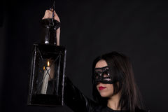 Girl in a black mask Royalty Free Stock Images