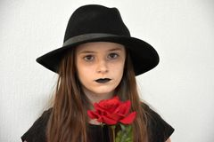 Girl with black  men`s hat and black lips Royalty Free Stock Photography