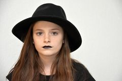 Girl with black  men`s hat and black lips Stock Photo