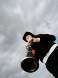 Girl on black playing on clarinet Royalty Free Stock Images