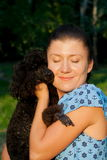 Girl with black poodle Royalty Free Stock Images
