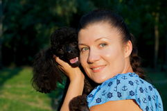 Girl with black poodle Royalty Free Stock Photography