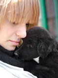 Girl with black puppy outdoor Stock Photos