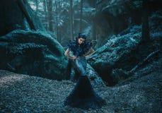 Girl - black raven stock images