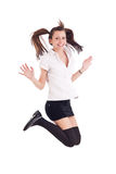 Girl in black short skirt jumping Stock Image