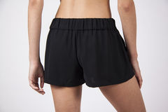 Girl in black shorts Royalty Free Stock Photos
