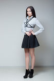 Girl in a black skirt and shirt with straps Stock Image