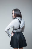 Girl in a black skirt and shirt with straps Royalty Free Stock Photography