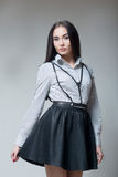 Girl in a black skirt and shirt with straps Stock Photo