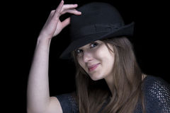 Girl in black with stylish black hat. Luxury glamour elegant adult girl in black dress with stylish black hat Royalty Free Stock Photography