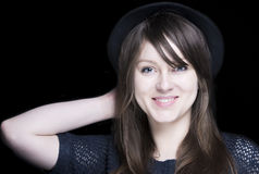 Girl in black with stylish black hat Royalty Free Stock Image