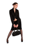 Girl in black suit holds bag. Royalty Free Stock Photos