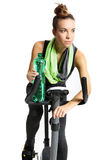 Girl in a black sweat suit riding a bike. And drinking water Royalty Free Stock Images