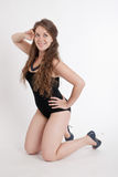 Girl in a black swimsuit Stock Image
