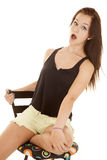 Girl black tank top shock Stock Photography