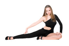 Girl in a black tight-fitting body suit dance Stock Photography
