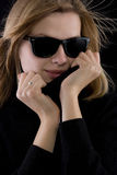 Girl in a black turtleneck with retro sunglasses Stock Image