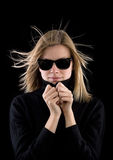 Girl in a black turtleneck with retro sunglasses stock photography