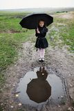 Girl with black umbrella Royalty Free Stock Photos