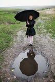 Girl with black umbrella royalty free stock photos