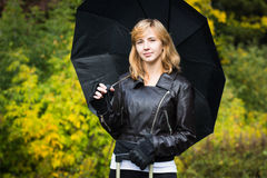 Girl with the black umbrella Stock Images
