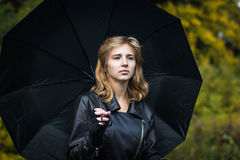 Girl with the black umbrella Stock Image