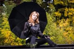 Girl with the black umbrella Stock Photo