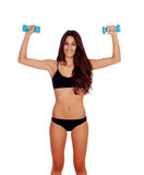 Girl in black underwear with dumbbells Stock Photos