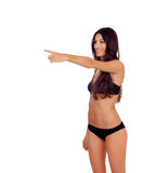 Girl in black underwear pointing something Royalty Free Stock Photo