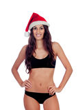 Girl in black underwear and a Santa hat Stock Images