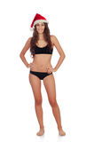 Girl in black underwear and a Santa hat Royalty Free Stock Photography